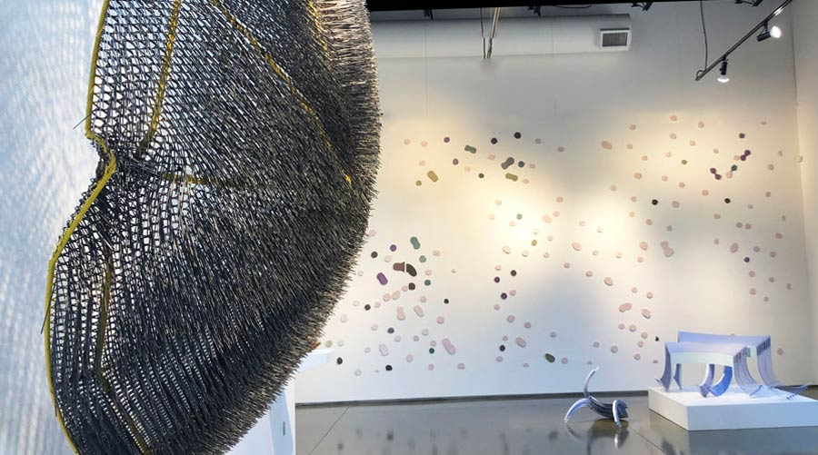 "Paula Castillo, ""Moon Pie,"" 2019. Steel mesh and landscape ties, 111"" x 38"" x 111"""